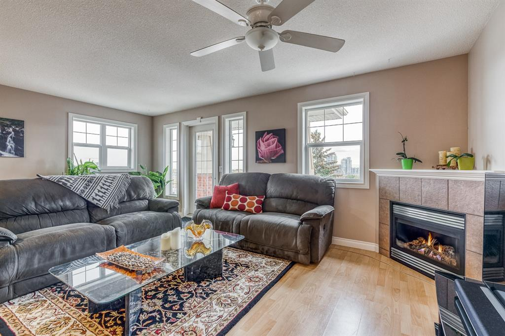 Click on the 3D Virtual Tour.  Just reduced $20,000. Charming and Bright, South facing, Top Floor Corner, 1082 SF 2 Bed 2 bath plus den corner suite with stunning DT and Bow River Valley views on a Cul-de-sac in Crescent Heights. Features include an open plan with laminate and tile flooring , with no adjacent neighbouring units. The kitchen has full sized appliances and a raised breakfast bar with granite tile counters.  The living room with a a cozy corner gas fireplace and spectacular DT views that opens to the South facing covered balcony.  The master retreat has sufficient room for a full King sized bedroom suite.  Generous sized walk-in closet with built-in shelving and a 4 piece ensuite bath.  The 2nd bedroom has glorious morning sun.  The den or flex room, located at the entrance to the unit. The full main 4 piece bath includes insuite laundry.  1 titled underground secure parking with 2 storage sheds is conveniently located on the lobby level.  Walking distance to DT and 1 block to transit.  This Building has a Walk score of 79.  Quick possession available.