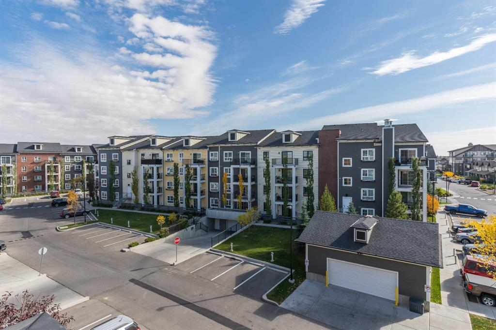 This TOP FLOOR unit  condo is located in Copperfield, with 9 foot ceilings and located in an award winning community . This unit boasts just over 800 SQ.FT of living space, with 2 BEDROOMS, 2 BATHROOMS and IN SUITE LAUNDRY. This contemporary layout maximizes space with  a bedroom and bathroom at one end - the master bedroom, walk-through closet, and ensuite on the other. The dining area, kitchen and living room are at the centre, with sliding doors to private balcony perfect for enjoying morning coffee & evening bbq?s. An open concept floor plan perfect for entertaining. The kitchen features STAINLESS STEEL APPLIANCES, GRANITE COUNTERTOPS, a LARGE ISLAND with EATING BAR, and ESPRESSO CABINETRY. The engineered HARDWOOD, plush carpet , upgraded lighting and plumbing fixtures, sets this condo apart.  This unit comes with TITLED UNDERGROUND PARKING and a STORAGE LOCKER. Parks and playgrounds, public transportation, amenities and shopping + pathways are all nearby. Also easy access to the South Calgary Hospital, Deerfoot trail , 22X & 52nd Street .A perfect place to live at an affordable price, as its PRICED TO SELL!  A pet friendly building with Low Condo Fees that include Heat and Water/sewer ***Investors and first time home buyers - you don't want to miss this opportunity ***
