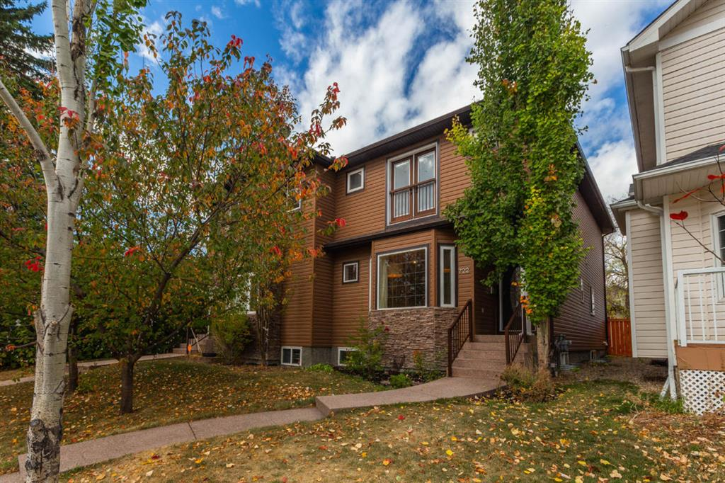 To learn more about this property, click the More Information button below.  This affluent two-storey attached build is located in Windsor Park. Ideally located for rapid access to downtown,  major city highways and shopping needs, this home is surrounded by a wealth of parks, recreational facilities, the Elbow River, schools, and tree-lined streets where neighbors enjoy a rich social yet  peaceful life. Equally appealing to busy professionals and active families, the property offers the demanding buyer a rich combination of quietness, spaciousness, upscale comfort, outdoor freedom, and investment stability. The home comprises over 2300 square feet of living space; four bedrooms and 3-1/2 baths; a superb basement fully equipped for entertainment and work; a detached full size double garage bounded by a fully paved back street; and luxury finishes that give this contemporary home an exceptional quality of living. Hardwood floors cover the main level. The main entrance welcomes you with a wall-high library surrounding an inspiring parlor. The kitchen which boasts granite counter tops, ample cupboard space, ambience lighting, and a breakfast bar. The kitchen opens on the dinning and social areas, with a direct view of the gas-fired fireplace. A powder room completes the amenities. Both main and second levels are brightly alighted by expansive windows on all sides. The second level hosts the master bedroom, its adjoining en suite bathroom and two walk-in closets; two bedrooms easily converted to offices, if needed; the laundry room; and the second full bathroom. The basement was professionally designed six years ago and boasts a fourth bedroom with ensuite bathroom and   sliding French doors which open unto the opulent social room, complete with surround sound theater amenities, a luxuriant electric fire place encased in a floor-to-ceiling slate panel, and an open floor for a study, yoga, or office area. Handcrafted hand railing and a continuous, sinuous hardwood ledge complete the welcoming feel of the sanctuary. The tranquil backyard is fenced and accessed through patio doors from the main floor. A mature, stately tree provides refreshing shade in the summer. It once anchored a three-level tree-house complex for the owners? children between 2007 and 2015. The backyard is garden-ready and pet-friendly. The home is equipped with unusually spacious storage areas in the basement and in the garage. Located just a short walk to schools, shopping & transit, this property shows exceptional value in one of Calgary's most affordable inner city neighborhoods.