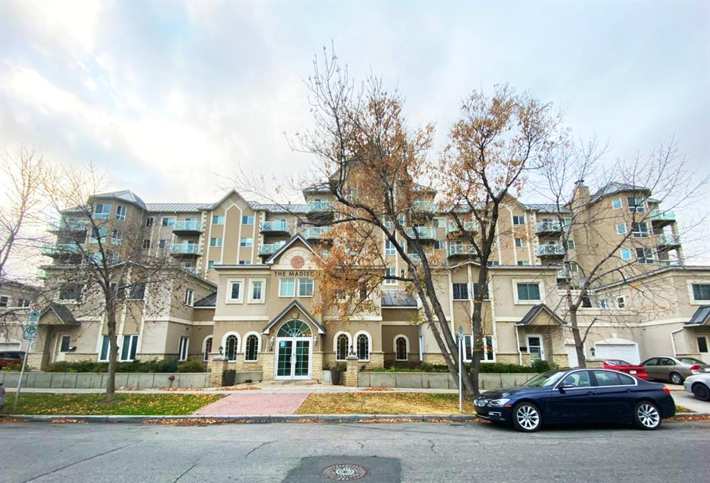 Located in the Desirable Community of Crescent Heights. Great floor plan with 2 bedrooms split by a cozy living area with gas fireplace, 2 full baths, quality finishings, features 9' ceiling, granite counter tops in kitchen, luxury vinyl flooring through out. HUGE balcony for entertaining guests on summer night or just to relax and sun tan!  You won't find outdoor space while enjoying condo living anywhere else. The master bedroom features walkthru closet and ensuite bath. recently painted, sliding door opens to huge 37x17 ft west facing private patio. will include full patio set and storage shed. enjoy mountain views, sunsets and the downtown skyline. access to exercise room & shared bbq terrace located on the same floor, heated underground parking included (titled). This Great Location is easily accessible to shopping on ground floor in the building including Caf�s, Restaurants. Central location easy access to all major routes, shopping, and to Downtown.