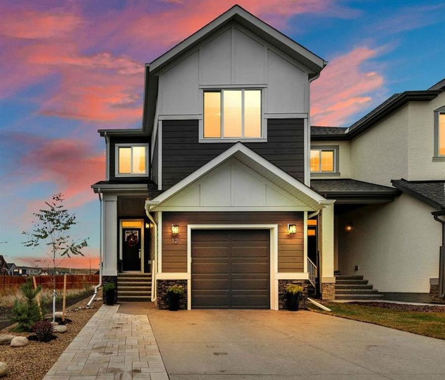 """From pathways along the river to the natural beauty and park like setting, Riverstone is the perfect place to call home!  Built in 2019, this 2 storey home is exquisite and the attention to detail is sure to impress!  Notice the tumble stone entrance and exposed aggregate driveway as you arrive - the exterior finishes are classic and timeless.  Boasting over 1980 sqft,  this 3 bedroom, 2.5 bath home is warm, inviting and offers all the elegant upgrades you would expect in an $700k+ estate home - the bright, open floor plan has 9' ceilings and  beautiful wide plank flooring (LVP) throughout the main level.  The kitchen has upgraded quartz countertops, a large island with an extended eating ledge great for entertaining.  Full height cabinets (42"""") finished to the ceiling, upgraded smudge proof stainless steel appliances, a slide in gas range, undermount microwave,  2 door fridge (plus freezer drawer) and an internal filtered water dispenser.  Designer lighting and upgraded fixtures are featured throughout.  The walk thru pantry was thoughtfully finished with pull out pantry cabinets, a wine rack and recycling station to maximize the space and compliment an eco friendly lifestyle.   The upgrade on this single garage is a rare find - notice the extra high ceilings and side winder garage opener compatible for future car lift (for the car enthusiast in the family).  The dining area & living room  are spacious and offering plenty of natural light with large picture windows.  Step outside to a fully landscaped, low-maintenance outdoor space!  This back yard is truly an oasis!  Custom designed by the home owners, they have created a private, relaxing outdoor space perfect to entertain or to simply enjoy. The living space continues back inside, upstairs - with a large bonus room that functions well as a home office or tv room,  a large master bedroom with 5 pc ensuite bath and walk in closet.  2 more generous size bedrooms, a  4 pc main bathroom and separate LAUNDRY room conv"""