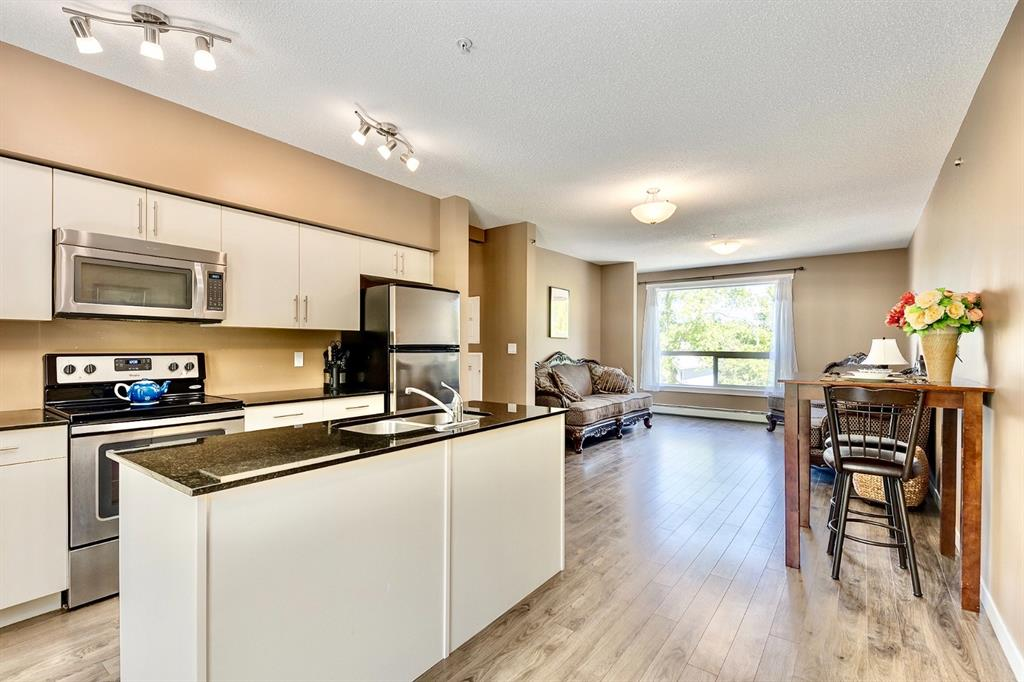 MOVE IN BEFORE XMAS!  SUPERIOR central Location   MODERN Open-Concept   2 Bed 805 sq ft   HIGH 9 ft Ceiling   IMPALA GRANITE   Now is your chance to own the LAST unit left in this NEWER 2015 award winning 'Jeremy Sturgess' designed complex located close to SAIT, a quick walk to downtown, transit & amenities. Step in & be greeted by a chef's kitchen - featuring bright white cabinetry, granite counters, & S.S. appliances. Extra-high 9' ceilings & large windows add to this units airy, bright & inviting ambiance. Floorplan connects the kitchen & living area seamlessly, making this large unit feel even bigger. Two great sized bedrooms await, each w/ huge closet spaces to keep tidy. The full bathroom is also fitted w/ in-suite laundry. This unit also has a flex space. Take a nice break out on the quiet private balcony. Don't forget, 1 underground (titled) parking stall & plenty of visitor parking! Incredible contemporary design inside/out, this complex even includes a trendy central courtyard - this brings in more light for the complex/units, a place to hang out, & beautiful greenery. The complex is well managed & low-maintenance, you only need to turn-key and relax.  An option to have 6 months condo fee included makes this a fantastic choice. These don't come up often and is also the BEST priced unit in the area!  Your next place awaits - book your viewing today.