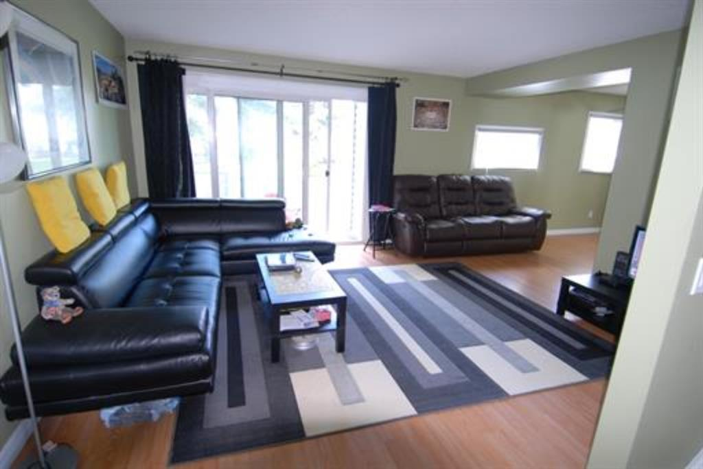 Fabulous 3 bedroom, 1.5 bath home with fully developed basement in a super quiet location! The windows & sliding doors spill an abundance natural light into large rooms throughout this very functional & open floor-plan. Relax in the extra-large living and dining areas with open sight lines & easy access to the kitchen...white & bright with big window, microwave/hoodfan & pantry. 3 upper bedrooms include the generous master bedroom with double closet & enough room for a desk. Easy care laminate floors on the upper 2 levels. The fully developed basement has a big family room, large laundry & storage room plus a 2 piece bathroom. Enjoy a sunny barbecue on your large west deck with private fenced yard. This quiet well maintained complex sides onto a large green space with playgrounds and recreational facilities. The condo fees include water & sewer and 1 parking stall. A great opportunity to move in without having to worry about doing any work!