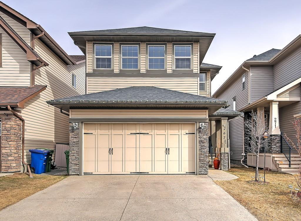 WELCOME HOME! This gorgeous TRICO-BUILT home in the popular community of HILLCREST is COMPLETELY DEVELOPED! The main floor is beautifully laid out with a den/office space off the foyer and a 1/2 bath and mudroom leading to the DOUBLE ATTACHED GARAGE. The main living area is an OPEN CONCEPT with 9 ft ceilings and many windows allowing for lots of light.  The kitchen boasts plenty of COUNTER SPACE and CABINETS, GRANITE counter tops, HUGE island, pendant and pot lighting, Stainless Steel appliances and TILE BACKSPLASH The family room is spacious with an attractive STONE-surround fireplace and mantle.  Completing this level, is a dining area with a door that leads to the 2 tiered deck and HOT TUB, great for entertaining!  Upstairs is a fabulous VAULTED BONUS ROOM, wet bar, laundry, 2 good sized bedrooms, large Master Bedroom with a 5-piece en-suite and walk-in closet. Enjoy the 4th bedroom, living room and bath in the basement. Also has built-in ceiling speaker system. Hop, skip and jump to the shopping area. You wont want to miss this one!
