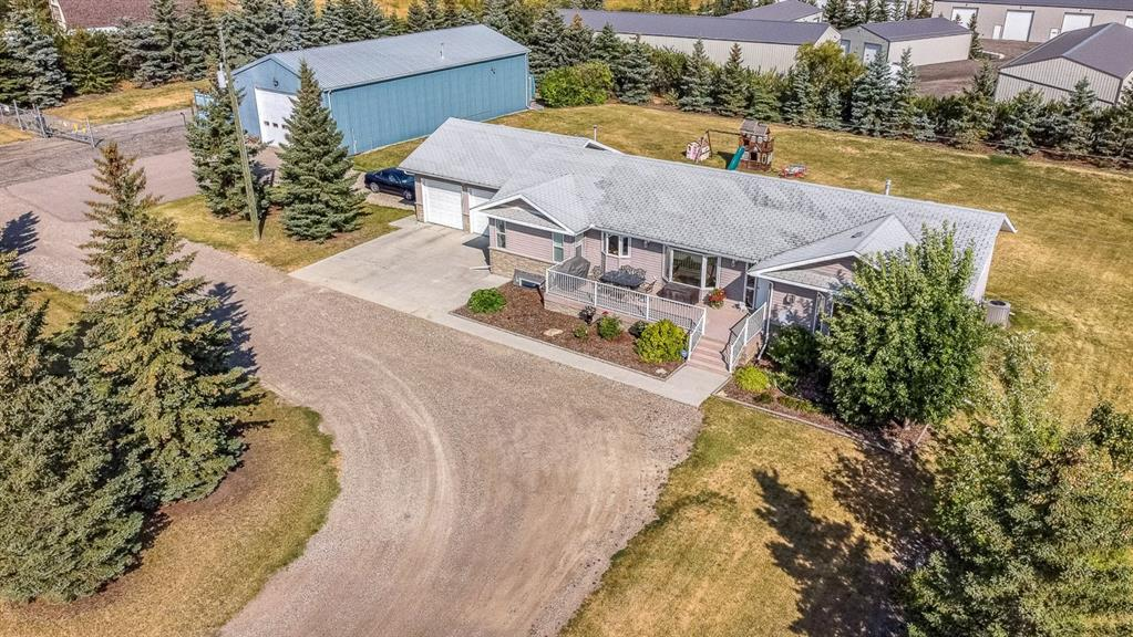 A TRULY UNIQUE AND EXCEPTIONAL PIECE OF REAL ESTATE ? Check out the VIDEO TOUR. If you are considering a change in lifestyle, a career change, expanding your current business or to transition into retirement then this property cannot be overlooked. A total of 8.97 acres (ONLY HALF THE LAND HAS IMPROVEMENTS! Imagine the potential) located just south of Okotoks, this land allows for quiet enjoyment of the acreage life with the ability to easily expand this profitable storage business all while you enjoy gorgeous skies and big views. The successful garage / storage business offers 26 garage units varying in size from 600 to 1500 square feet featuring 10 and 14 foot garage doors, secondary man doors, 15 AMP internal plugs, LED lighting, finished concrete pads, insulated and dry walled and some with separate meters and heat ? with approval for immediate expansion of 4 new buildings! The property is gated and monitored with CCTV and is nicely landscaped for privacy and appeal. The 1731 square foot bungalow with a full basement is well laid out with generous and sunny rooms. The home can easily accommodate a family or empty nesters with the grand kids ready to visit and enjoy the huge and private back yard. Upgrades include a newer septic system and mechanical systems. It is a must visit.