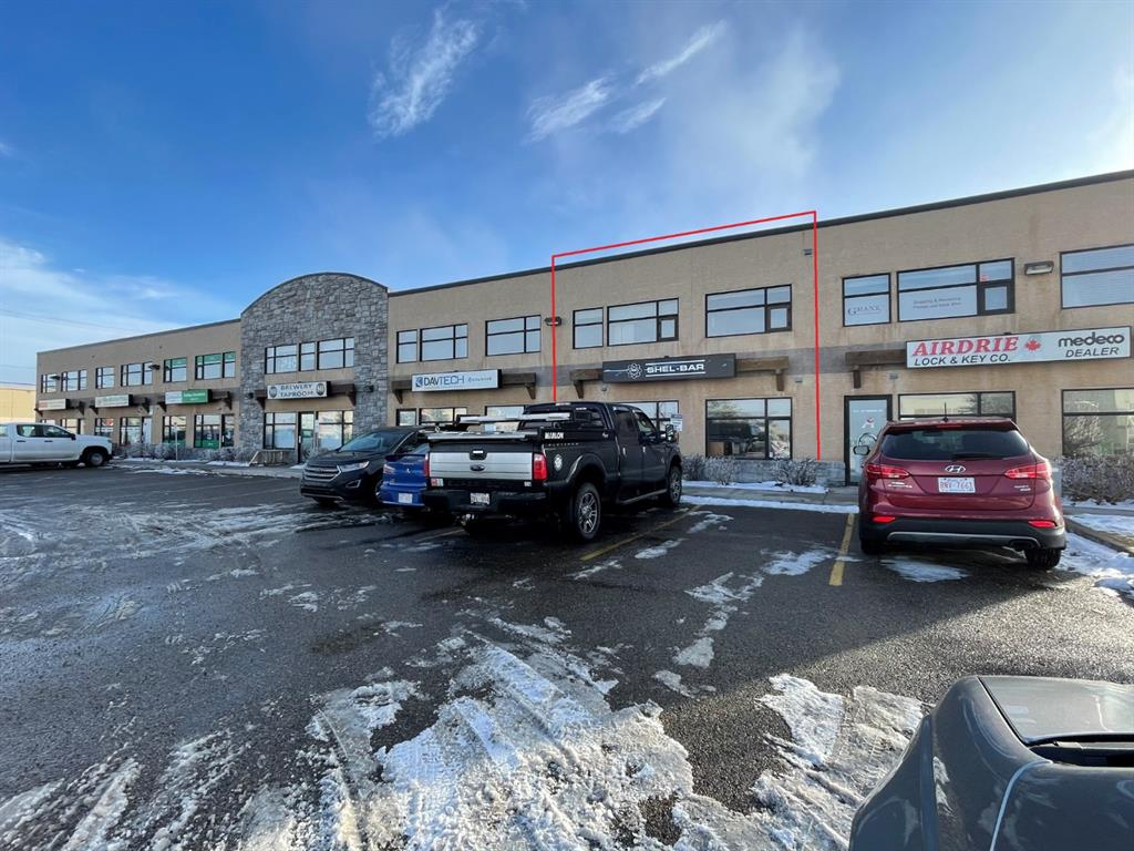 Great opportunity in Kings Heights! This beautifully finished 1920 sq. ft. industrial bay with an additional 1440 sq. ft. mezzanine developed into offices and a shop space. There is a 14 ft. automatic overhead door with 18 ' ceilings in the back,  forced air heat and AC in the front offices, and overhead forced air heat in shop. This unit has excellent views and exposure, with lots of stall parking. All reception furniture is included in sale. Natural gas and electricity average 350$/month. Two parking stalls around back are assigned, current owner pays $100/month for four extra stalls, with ample shared stalls out front. Please call today to view!