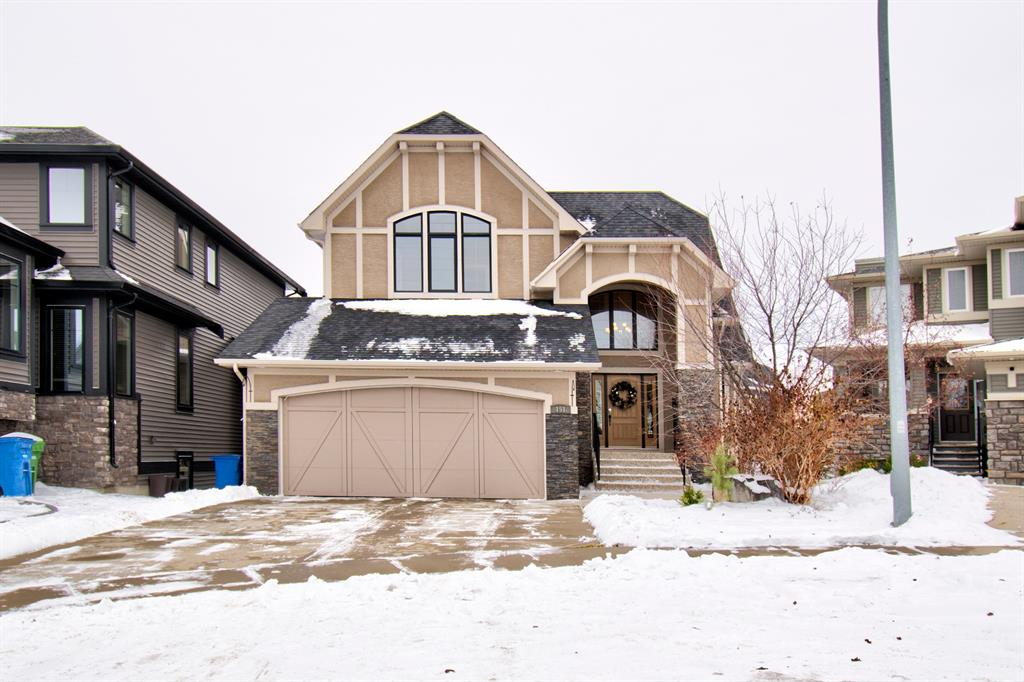 Welcome to this STUNNING Custom Designed Home!   Located on one of the nicest Cul De Sacs in all of Coopers Crossing. Fully developed walkout with a SW backyard.  This home has some serious WOW factor from the moment you step inside. Grand entrance with high vaulted ceilings , curved staircase up and down with maple and wrought iron railings. Main level den with built-in maple cabinetry,desks and shelving. Bright white kitchen with granite, large island with tons of drawers, huge pantry and stainless steel appliances.  Large impressive master suite  with vaulted ceilings, 5pce ensuite with custom cabinetry, his and her sinks, soaker tub and separate shower. Lower level is fully developed with  a massive  recreational area, wet bar, additional 4th bedroom , full bath and mechanical room with plenty of storage.  This home boasts many other features including  engineered hardwood with hand hewn finish, in-floor heat on the lower level, 2 H2O tanks, central A/C, 2 fireplaces with stone surround, built-in media centre, built-in shelving and wall niches.  Private low maintenance back yard with mature trees and a large covered patio area that is perfect for summer entertaining.  No lawn to water or cut in back as it is artificial grass that stays green all year long.  Both furnaces just serviced Nov 19, 2020.