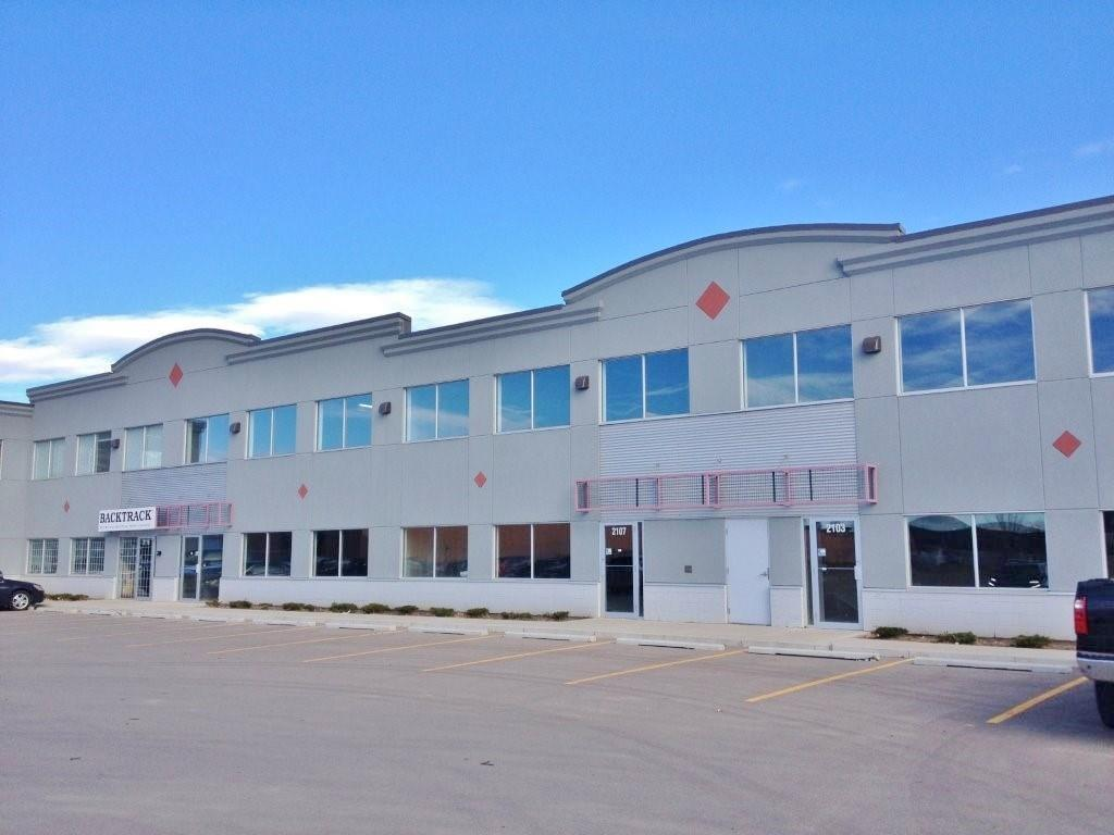 4,275 Sq.Ft. Industrial Condo unit in shell condition, additional 1,002 Sq.Ft. of Concrete mezzanine that can be developed into second floor office space. Great opportunity for the company that requires a showroom and office space in addition to warehousing. Large marshaling area at rear of bay.