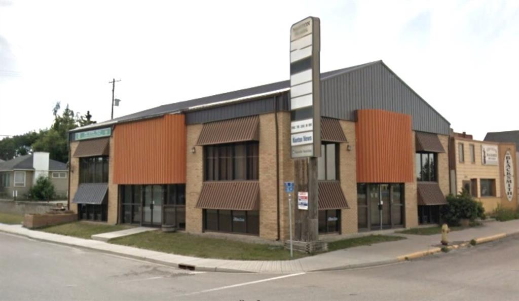 This building is offered for lease, triple net asking base rent of $3/sqft + ops (est $2.5/sqft (includes basic utilities) Great visibility located on Hwy 2 north; Fantastic owner/ user opportunity only 40 mins south of Calgary.  This building currently has numerous office spaces that can be easily reconfigured; paved parking lot off the alley (estimate 8 stalls); newly upgraded high-efficiency boiler system with 2 4.5 tone & 2 7 tonne units; 400 amp service along with 2 - 100 amp panels; T-28 lighting throughout; fiber optics in the back alley.
