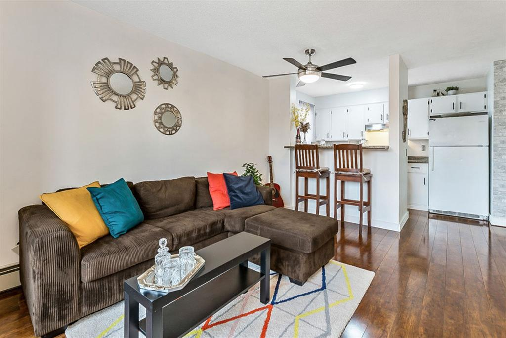 Why rent when you can own!  Look no further, this unit has it all with a great layout, lots of natural light, an open/functional floor plan and cozy living room with access to the balcony where you can enjoy the views and neighbourhood.  This Fabulous one-bedroom condo comes with PARKING in the Desirable Community of Bankview! The kitchen has plenty of cabinetry and includes a built-in breakfast bar area.  The master bedroom is spacious and the bathroom has been updated.  LOW monthly condo fees INCLUDE HEAT & WATER, as well as exterior maintenance and is professionally managed...the best part is, you even have COVERED PARKING!  This extremely desirable location is central and walking distance to transit as well as so many amenities including coffee shops, bakeries, restaurants, shopping, nightlife and so much more on 14th Street, 17th Avenue, and Marda Loop.  You're also minutes to downtown, U of C and Mount Royal too!   If you want to live an inner-city lifestyle, or if you're looking for a fantastic investment opportunity check out the tour for a virtual walk-through then call your favourite realtor for your private showing today!