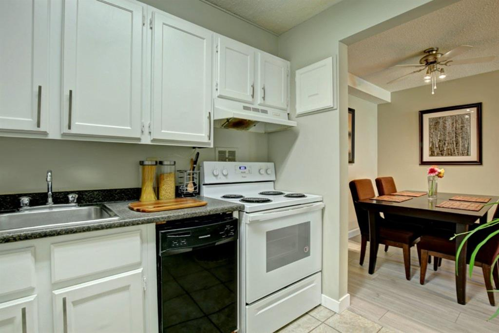 """$$...INVESTOR ALERT...$$ Buy for less than rent. Nothing to do but move in. Fantastic Location in """"Southampton Green"""". This is a large main floor 2 bedroom unit has a WEST facing patio leading to the green space. Great Floor Plan, tastefully renovated with Fireplace in the Living Room & Sliding Doors Opening to the main floor patio for easy access. Large Windows offering lots of Natural Light! Spacious Master Bedroom with Walk-In Closet! Good sized 2nd Bedroom! In-Suite Storage! Well Managed Complex with low condo fees too. There are a ton of amenities: In the club house there is Tennis & Racquet Courts, Library, Rec Room,  & Fitness Gym! Walking distance to LRT, South Centre Mall, Schools,  & Easy Access to Deerfoot Trail! #3 Bus Route. PRICED TO SELL!!! New laminate flooring throughout. Ceramic Tile flooring in the entrance, kitchen and bathroom. Bright white cabinets, updated appliances. Master bedroom has a large bright window and large walk in closet. Adjacent second bedroom is also spacious. New Windows throughout. Assigned stall #61 just out front. Quick possession. Sorry, No Dogs Allowed."""