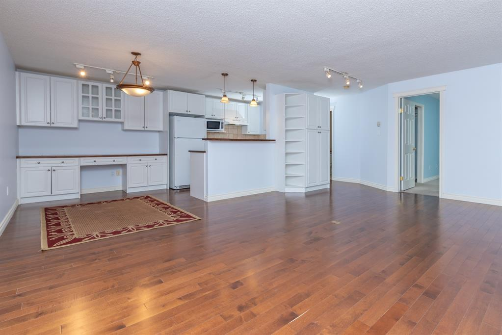 Bright and open-top floor unit, 1 Bed 1 Bath. The kitchen has tons of cabinets and counter space, including a raised eating bar. Two large windows in the bedroom with a large walk-through closet and an additional double closet. Beautiful hardwood flooring. Enjoy views from the balcony. Location is superior: Jump on the LRT (barely a block away) & be downtown in minutes or enjoy the many amenities and shops along 17th Ave. Only minutes to Westhills or out of town. Well managed condo. Fitness room, entertain family/friends in the party room, bright laundry facility with card system, access to bike storage, covered parking, visitor parking, and pet friendly with board approval.