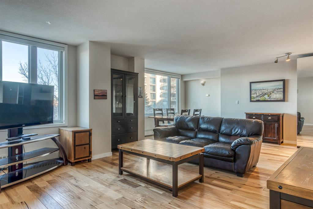 This beautiful 2 bedroom, 2 bathroom corner unit with unobstructed views of the Bow River has been fully renovated with high end finishes throughout. Located in the highly desirable community of Eau Claire this unit is just steps from the Bow River giving it one of the best locations downtown possible. The unit features engineered hardwood flooring throughout, gourmet kitchen with full height cabinets, granite countertops, glass backsplash and stainless steel appliances. Gorgeous views from the newer windows, upgraded washer & dryer, built in Murphy bed in the 2nd bedroom and in-suite storage. The master bedroom has a four piece ensuite and the main bathroom also has four pieces both that match the design and style of the kitchen. The building includes a massive rooftop patio perfect for watching sunsets and fitness room. Underground parking stall also included with the unit.