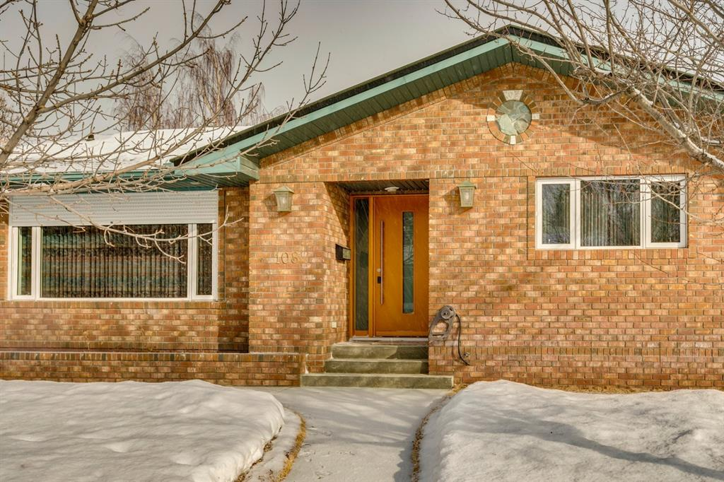 This amazing bungalow with over 3150 sq feet developed spaces located on a quiet street : paved alley and close to schools ? c/w with an insulated , 220 volt powered heated triple detached car garage of 645 sq feet .Exterior is constructed with a low maintenance approach. Fully bricked with an extra exterior insulation wrap. Cedar fence posts are mounted on a concrete retaining wall: Underground roof and patio drainage: Sprinkler system: Poured sidewalks: Cedar sided shed: Brick lights and outdoor motion lights: Outdoor fireplace : Roman paver patio c/w gas bbq outlet: Metal roofing: All exterior wall cavities are insulated with a blown in insulation creating a heat efficient and very quiet interior: Keyless fob entry doors to both the house and the garage. 2 Bedrooms and an office on the upper floor. The living room has been separated from the kitchen to provide some quiet from the kitchen. Roll shutter on main window for light and heat control. The main bath is a full bath with separate shower c/w floor heat and jetted tub. The master bedroom has a large built in clothes closet. Kitchen and 3 season sunroom allow a view of the garden in the back. Sunroom and all tiled and laminated flooring in the house has separate In floor heating. The basement has a large entertainment room c/w a gas fireplace, 2 large bedrooms , hobby room, and a large laundry room . Hallway has amazing storage closets including a cold storage room under the stairs. Downstairs bathroom is tiled floor to ceiling with a built in steam shower. Two forced air furnaces , water softener, and hot water tank are in the mechanical room.