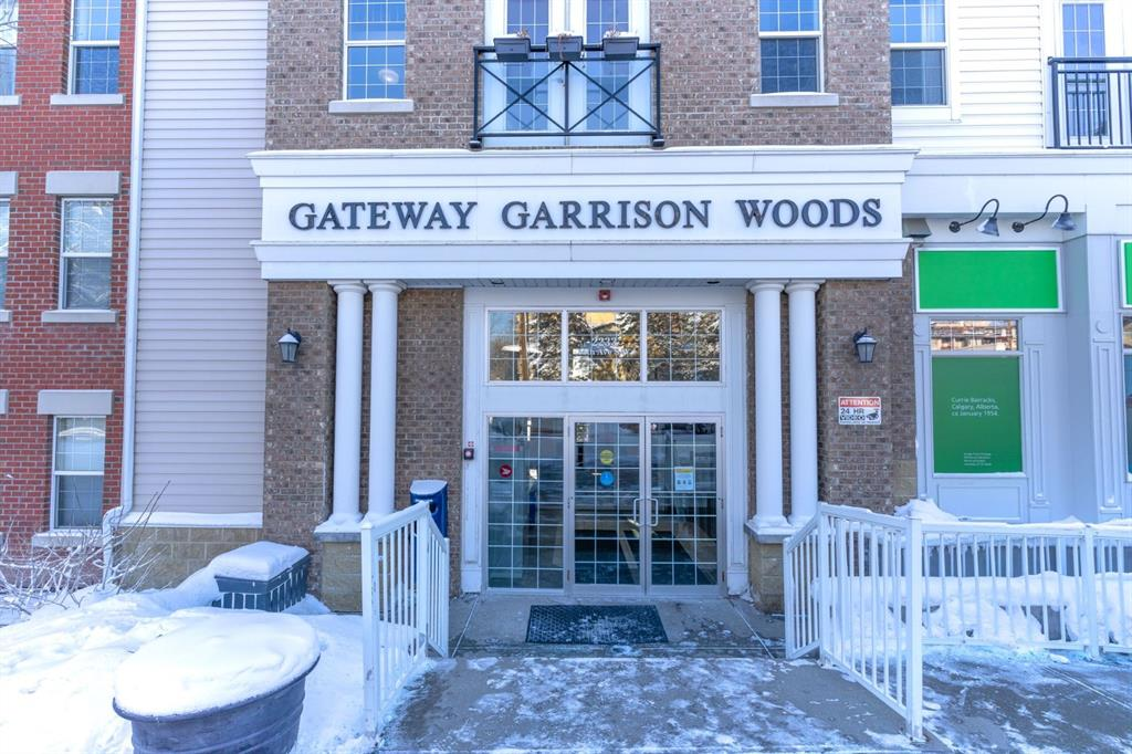 Welcome to Garrison Woods... This highly sought-after Marda Loop complex is nestled with-in some of the trendiest shops, restaurants, cafes, gyms, yoga studios & walking paths. The 3rd floor loft unit has elevator access & a separate hallway entrance to the loft master bedrm. This 1 bedrm 2 bath unit features high ceilings, all new paint, carpet & laminate flooring which makes it move in ready! The entrance opens up to a cook?s kitchen with stainless appliances, granite countertops & a nice open area for dining & lounging.  Several large windows are shared with the loft & the walkout patio doors, allow for maximum light. The master loft has a 4 pc bath, washer dryer & large open concept closet. Unit also features a large patio facing the private courtyard with gas line for fun barbecuing, toasty in-floor heating & bonus, all utilities included except internet!! **Add a coveted titled (owned) convenient indoor parking stall & a rare titled (owned) storage locker with over 600 cu ft of space & you are home.   It?s Marda Loop with a life style second to none?& these loft condos don't come up often... so don't miss out as spring is right around the corner!!