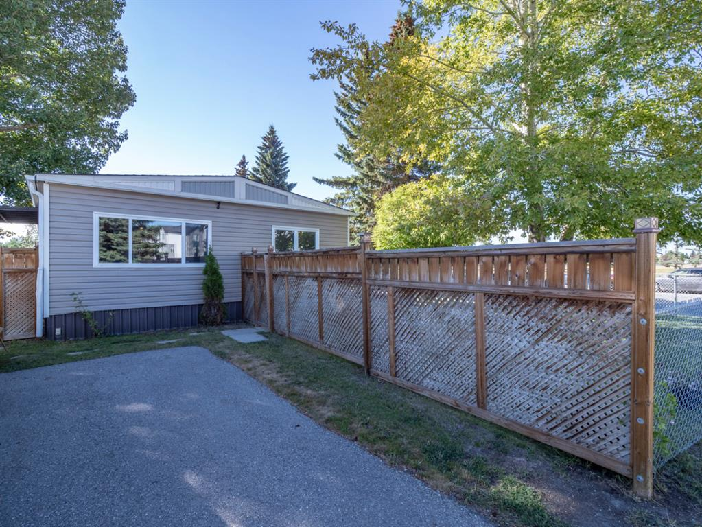 """Rare large corner lot with renovated double wide in Mountview mobile home park. This home has been substantially updated with drywall, new laminate flooring and full 3pc ensuite. The kitchen has been completely redone with new cabinetry, tile backsplash, gorgeous bamboo counters and stainless steel appliance package. The furnace was replaced in 2013, hot water tank 2018, shingles with a new membrane in 2014, all new windows in 2015 and new siding in 2015. This is one of the largest lots in the complex and has been meticulously maintained.  It also features an amazing 15x15 workshop for your projects with heat/power and an additional shed for your storage needs. Lot fee of $750/month includes water, sewer and garbage. Pets allowed 16"""" and under at the shoulder with park approval; some breed restrictions. Conveniently located just off 17th Avenue, close to East Hills shopping and bus routes.  Across 17th Ave is Elliston Park with it's numerous walking trails and a front row seat to Globalfest. If your looking for a truly quality home in a good location, look no further. Just move in and enjoy!!"""