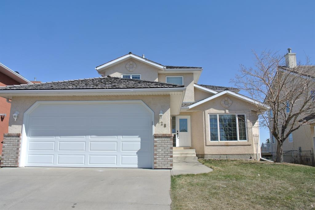 This wonderful family home is located on the 16th hole of Lakeside Greens Golf Course. This home is also situated only a short walk to the Chestermere Sports Plex, playground, skate park, shopping and the Lake.  Offering many upgrades including high end kitchen cabinets, builtin shelving, hardwood flooring, 2 fireplaces and newer furnace! On the main you will find an office, formal living and dining rooms, and  spacious kitchen complete with stainless appliances, a huge walk-in pantry and granite counters. The kitchen opens to the family room  as well as out to the huge upper balcony with gorgeous golf course views! Upstairs there are 3 large bedrooms. Your master suite is very spacious and has a large walk-in closet and 4 piece ensuite. The 2 other bathrooms share a 2nd full 4 pc bathroom. The lower walkout level is fully finished with a huge family room, games room and 4th bedroom. The double attached garage is heated and oversized so you can actually fit a truck.