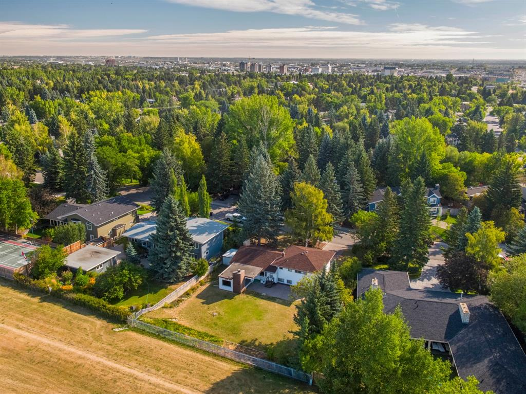 TERRIFIC BUILDING OPPORTUNITY! This wonderful, massive property is12,591 sq.? or .28 of acre? 80 ft. Frontage & 144 ft. deep.  Offering the BEST orientation.. A WEST backyard! BACKING onto a GREEN SPACE, near the walking /biking paths & reservoir. How wonderful?no neighbors behind you + a fabulous, large, PRIVATE property! QUIET STREET with gorgeous mature trees. BONUS-This original 4 level split with 3 bedrooms + 2 full baths is live able/rentable until the time you want to commence your new build. Offers living, dining, kitchen + family room on main with bedrooms on the upper level. Private yard + double attached garage. BONUS #2- Current owners have an APPROVED D.P. until 2022 & plans for a Fantastic  4000 sq.? home with 3 car garage, that they would provide to the buyers, at no cost. Mayfair is a highly desirable executive family neighborhood? enjoying parks, community playground, skating rink & quick access to Rockyview, golf, shopping/restaurants + downtown!