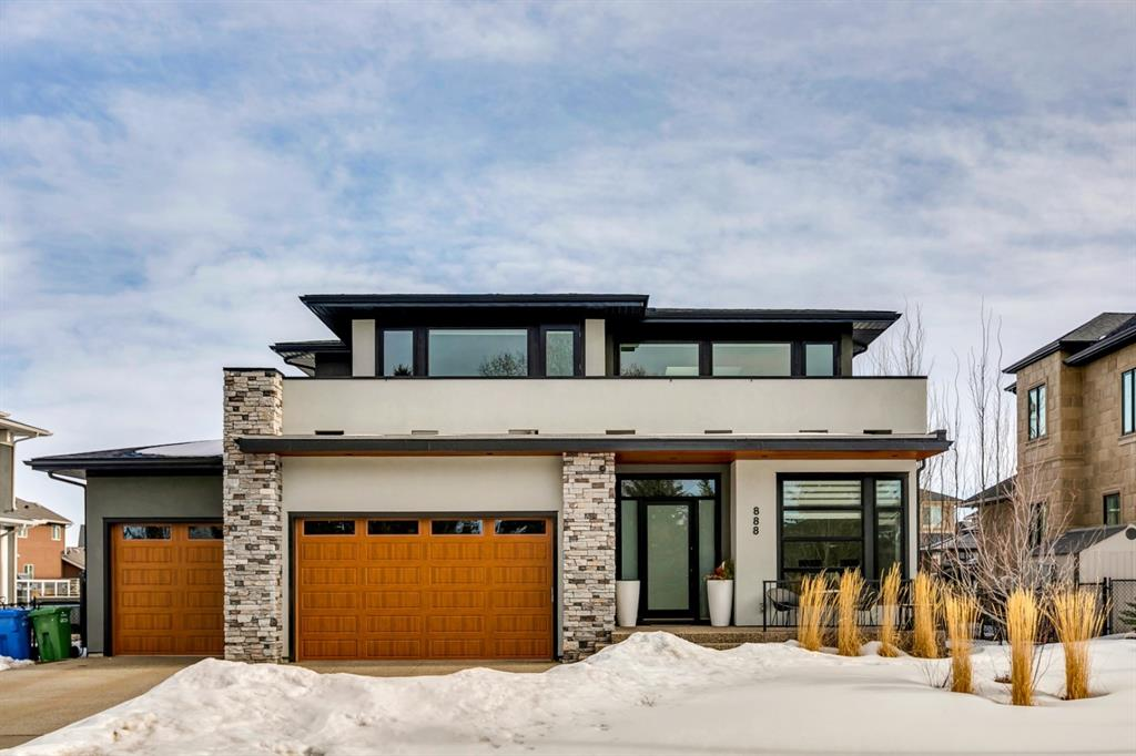 Welcome to 888 East Lakeview Road. This spectacular custom 2 storey luxury home is located on one of Chestermere?s premier streets featuring incredible curb appeal.  The 75ft x 122 ft lot boasts nearly 5000 sq ft of living space with an oversized triple car heated garage. Once you enter you are immediately greeted with clear sight lines and natural light from the large windows as part of the inviting open concept. As you walk past the large private office workspace you?re immersed in the details of the custom build: tiled foyer, wide plank hardwood floors, 10 ft ceilings, designer lighting package, with built-in speakers home automation & security.  Note the exceptional quality of the hand crafted cabinetry throughout the home including lockers and cabinets of the front mud room. The spacious living room featuring a beautifully designed fireplace perfect for gathering and relaxing. The Chef inspired kitchen is fully equipped with high end appliances, butler pantry and an abundance of cabinet and drawer storage.  Anchoring the center of this gourmet space is an oversize island perfectly designed for entertaining guests. Making your way up the distinct stairwell you?ll find a Master Bedroom with a spa-like ensuite that features a soaker tub with a feature backdrop, dual vanities, heated tile floors and oversize stand up shower.  Step onto your own private balcony with breathtaking lake and city views.  The walk through closet leads directly to the laundry room. There are 2 additional large size bedrooms upstairs with walk in closets, a full bath, and a bonus room living room area. The fully developed basement features in floor heating throughout a home theatre area with built in high end audio, full gym/fitness room, a rec area, bedroom with walk-in closet and full bathroom. Head back upstairs and make your way through the second mud room at the back of the home which leads to the massive two tiered patio deck designed for outdoor oasis - great for lounging and dining
