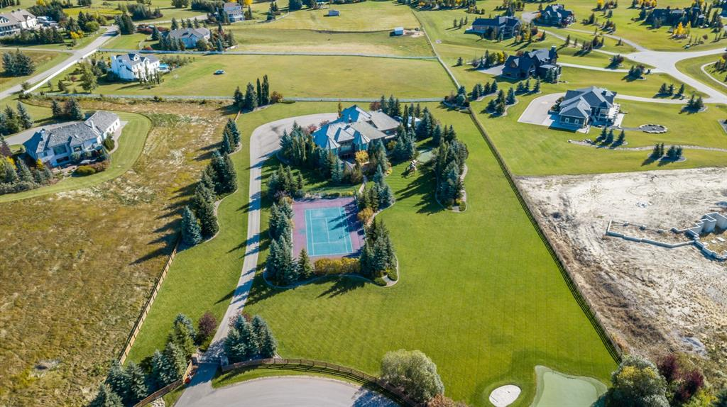 Presenting serene and private country living in the heart of Springbank. This exceptional custom-built home is located on a stunning and rare 3.88 acre lot in exclusive Spring Haven Estates. Streams of natural light flood every room as do magnificent views of the Rocky Mountains and the park-like setting. No expenses were spared and every detail has been thought of.  An outstanding home for entertaining - the kitchen has a space for everything, Lamok cabinetry, a butler?s pantry, 3 dishwashers, Sub-Zero, Wolf and ASKO appliances throughout.  The master bedroom and ensuite with jetted tub and steam shower is conveniently located on the main floor with 4 additional bedrooms.  The  walk-out lower level has been thoughtfully designed  with a full indoor recreation area, gym, wet bar, additional family room and 2 bedrooms that  walk out to the magnificent fully landscaped grounds. This immaculate outdoor living space will take your breath away.  Step outside to a full sports court (lit for night-time use); tennis in summer, ice rink in winter, basketball, hot tub enclosed under large pergola, outdoor stone fireplace, gas heaters, BBQ, fire pit and plenty of room to run and play. Two outstanding heated garages offer it all including  brand new Hayley Cabinets , spacious storage areas, large windows and indoor parking for up to  8 vehicles.  This  magnificent home shines with pride of ownership throughout.  This home is truly  all about family!
