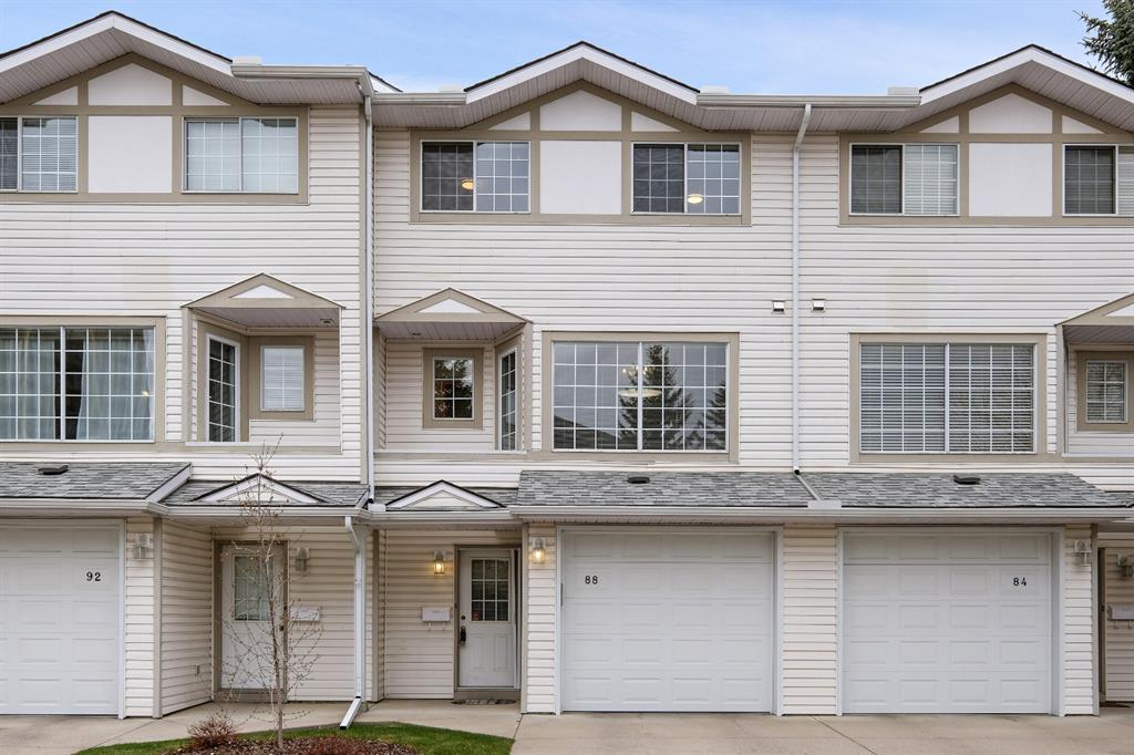 Bright and spacious 3-bed 3-bath Kingsland townhome with a superior location.  Move-in ready, with extensive updates which include: high efficiency furnace, hot water tank, kitchen appliances, all carpeting, LED lighting throughout, modern ensuite shower with tile surround, newer bathtub in guest bath, new garage door and opener, maintenance-free decking, newer paint top-to-bottom.  So close to all amenities including C-train, bus, schools, shopping, farmers market and countless restaurants, yet has a quiet, private location backing onto greenspace with mature trees and beautiful views.  Large Master suite with 3pce ensuite  and a walk- in closet with a window. Whole house is very spacious and very bright.  Cozy up on those colder nights with your gas fireplace in the living room. Attached garage with private driveway. Basement is unfinished with laundry and lots of storage.  Enjoy the morning sun as you eat breakfast in the large dining area, and the evening sun as you barbeque on your spacious deck with west exposure.