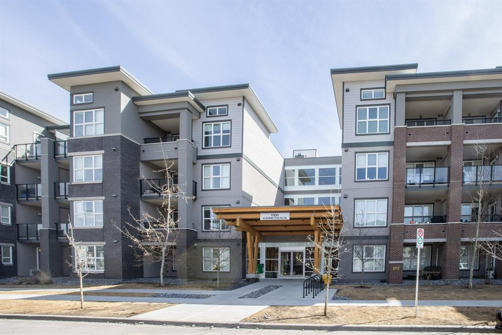 A rare opportunity to own an upgraded, contemporary designed, open concept TOP FLOOR two bedroom condo with CITY VIEWS.  This gorgeous unit comes with surprisingly high ceilings allowing natural light to flood the unit and is TURN KEY with furniture included.  Upgrades include hardwood flooring, high end kitchen cabinetry, marble backsplash, quartz countertops, outdoor natural gas for BBQ, a gas stove, laundry in the unit and double vanity sinks.  With one titled underground parking stall and assigned storage, a car washing station for residents and a courtyard to enjoy, this luxurious unit is built for stress free relaxation after a long day of school or work.  The LOCATION of this condo complex within Calgary is also exceptional as it is walking distance to Mount Royal University, gyms, swimming facilities, and is only minutes from downtown.  Ideal for the first-time buyers, students or working professionals.