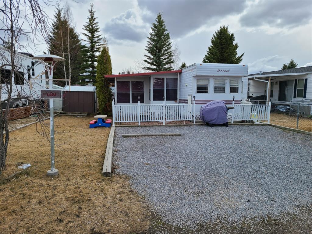 Great buy on this 1995 Kropf trailer with attached sunroom.  This fully furnished unit comes with all appliances, queen bed, 3 hide-a-beds and table with 4 chairs.  The spacious sunroom adds extra living space and has a wood burning stove.  Nice yard complete with shed and lots of parking.   Located in Phase 3 on Marina Drive.