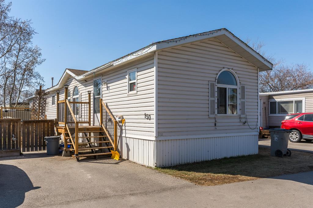 """Newer, bright and affordable. Located in Mountview Mobile Home Park with RV storage, this 3 bedroom/2 bath home is situated on a large lot. Features of the home include oak kitchen, plenty of cabinet space, moveable island & corner pantry. Built in 2000 this well designed 1200 sq. ft. home has vaulted ceilings, large master bedroom with walk-in closet and ensuite. The second & third bedrooms plus the other 4 piece bathroom are located at the opposite end of the home - perfect for a family or roommates. There's a large deck on the southwest side of the home for enjoying outdoor time in the sun. New furnace and heat tape installed in 2020, new roof 2021. Located minutes to East Hills shopping centre and Stoney Trail with transit on 17th Ave make this home convenient and easy to access. Across from Elliston Park gives you a front row seat to Globalfest when festivals return to the city. Lot fee for new owners $750/month. Pet restrictions 2 per home, dogs less than 15"""" at the shoulder and no dangerous breeds."""