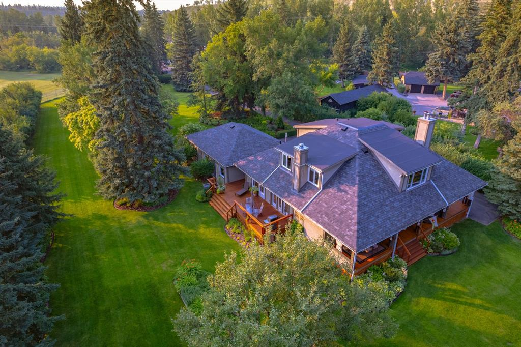 Amazing opportunity to have a country living experience right in the middle of the city.  This 35,520 square foot lot (.8 of an acre), which houses an impeccably kept + renovated 1.5 storey family home is a lovely country estate at the edge of Sandy Beach + just moments from downtown, all levels of schooling, shopping, pathway systems .  High level of walkability from here which is unusual for style of property.  Beautifully landscaped lot with 100 foot of river frontage.  The house is gated + the long peaceful driveway leads up to the house which has a wraparound veranda, welcoming entrances + very functional layout.  Main floor with gleaming hardwood floors + neutral decor.  Updates include the kitchen which offers ample cabinet + counter space, professional appliances including newer Miele dishwasher as well as new kitchen window offering loads of light.  Cozy family room with fireplace is just off the kitchen.  The spacious living room + dining rooms are both warm + elegant ideal for entertaining.  Large wood burning fireplace in the living room adds to the atmosphere.   There are lovely views from all rooms on this level.  Upstairs has been recently recarpeted + offers 3 bedrooms, all beautifully appointed, a family bath + laundry.  The master bedroom has gorgeous views of the river, soaring ceilings, built in cabinetry + deluxe spa ensuite bath complete with soaker tub, stand-alone shower + dual vanities.   The lower level is unspoiled with new mechanicals in 2013, with water proofing behind the insulation + ready for development, if desired by the buyer. The property is in the City but its taxes are based on Rocky View County's mill rate.  There is a well + septic system which is perfectly maintained.   Triple garage  located at the end of the entrance driveway. Many recent upgrades to this immaculate home including: 2 Lennox furnaces 2013, windows, asphalt shingle roof on house + garage, refacing of fireplaces, carpeting, hot water tank, air conditioner (see