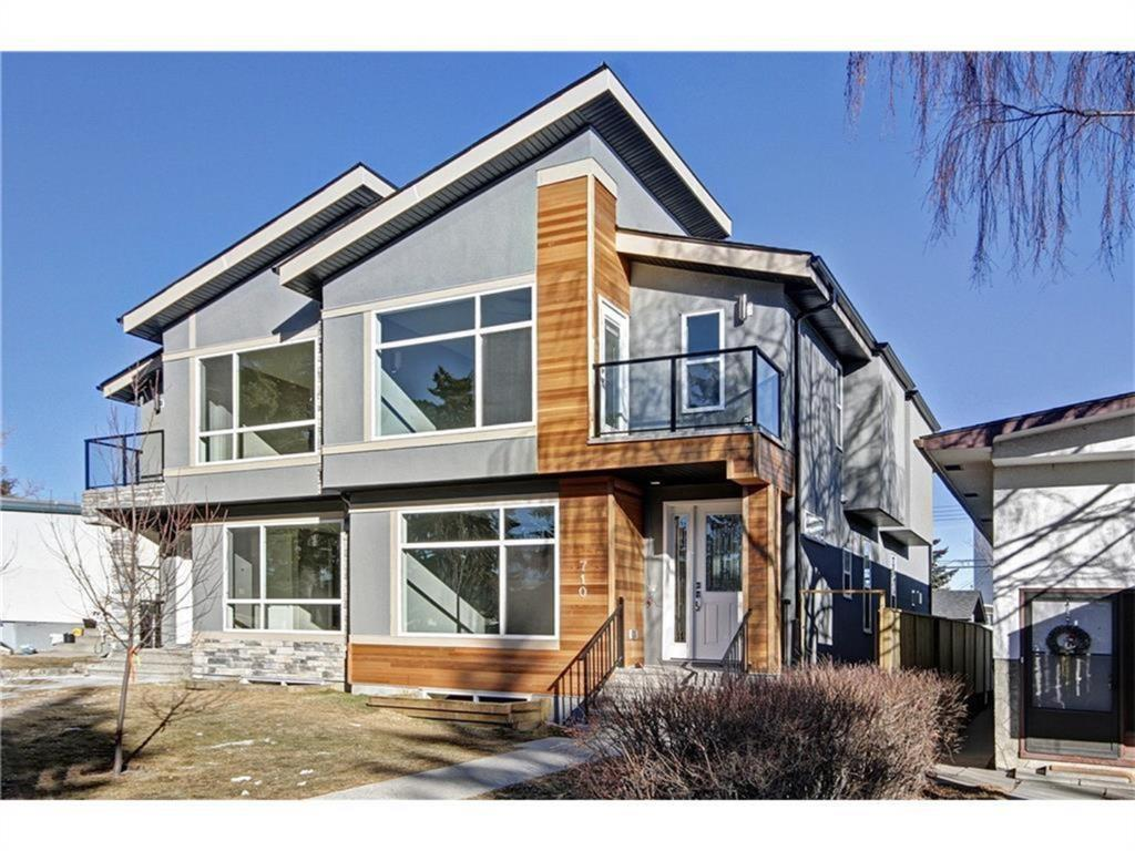 Stunning newly built in 2015 semi attached home located in the most DESIREABLE AREA of Kingsland SW minutes away from Chinook centre and C-Train. This south facing home is ideally laid out to capitalize on Natural light thru out the day. This modern 2 storey home comes with state of the art floor plan, designer lighting, beautiful built in system with a gas fireplace, Quartz countertops, Jacuzzi tub, amazing gourmet kitchen with ceiling height cabinets, all upgraded top of the line appliances and engineered hardwood flooring.