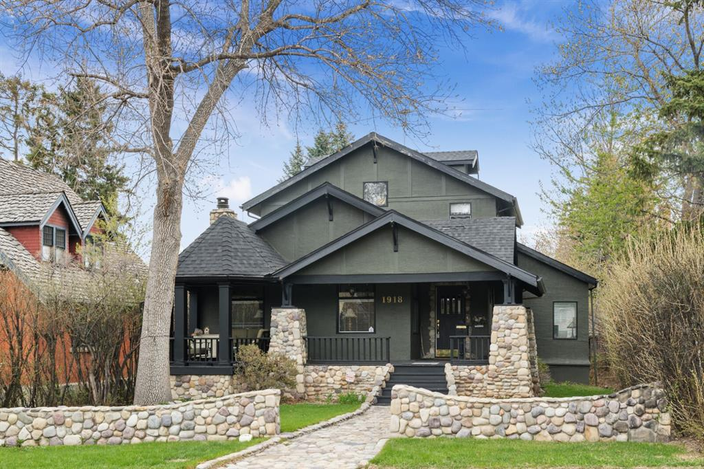 """Upper Mount Royal Extraordinary Bungalow with amazing """"Street Presence"""" - plus a """"Triple Car Garage""""!   Old world charm exudes as you are drawn into this magnificent masterpiece!  The ornate central staircase is the perfect backdrop to the formal living room, complete with its vaulted ceilings and feature stone wood-burning fireplace.  The main floor parlour is perfect for your office space.  The RENOVATED gourmet kitchen features Legacy cabinetry,  quartz counters & backsplash,  plus high-end stainless steel appliances - DSC -(including a gas stove with a grill & griddle, plus 2 ovens).  The spacious central dining area is adjacent to the great room, which has 3 skylights and large windows to allow an abundance of natural light.  Perfect for entertaining, the open-concept living space extends through to an expansive sunny deck.  Enjoy sunny mornings on your private rear deck and sunny evenings on the charming large covered front veranda!  Ascend to the sumptuous master suite, complete with a gas fireplace, 5 piece spa-like ensuite & a sunset juliette balcony! The basement is fully finished with 2 flex rooms (could be bedrooms), a 3 pc bathroom and a main recreation area.  New roof in 2006.  High-end Trane furnace.  Steps to the magic of 17th Avenue, with its shops, restaurants  & amenities.  This property truly offers a unique home and lifestyle that is """"one-of-a-kind""""!"""