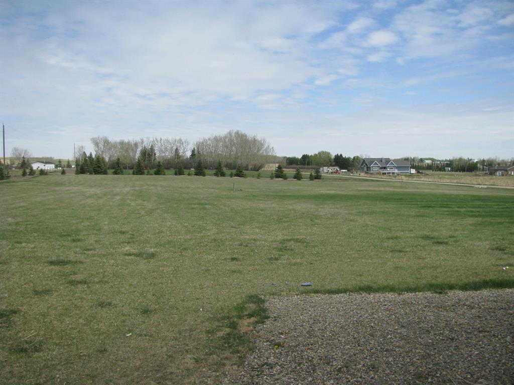 2650 SQ. FT.  Bungalow  on 4.99 Acres m/l  with 38 ft. X 25 ft. garage west of cross iron mall. Acreage living with a city of Calgary view. Tall ceilings on main floor and basement.  This huge property could be updated to meet your most desireable standards.