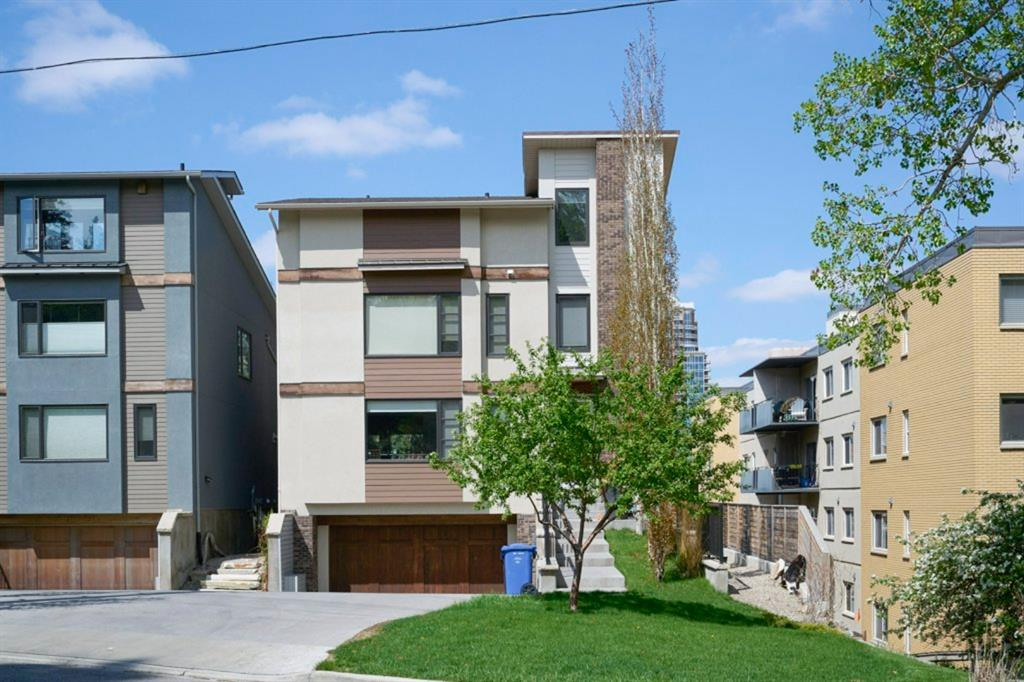 Stunning air-conditioned contemporary Urban residence home located in the heart of Mount Royal. This very bright and open plan with extensive upgrades and built-ins throughout has 3615 sq ft on 3 levels with 10ft main floor ceilings and 9ft on the 2nd, 3rd and basement.  3 bedrooms, 6 bathrooms, flex room ideal for a living or dining room. Gourmet kitchen with stunning glass cabinetry with a huge centre island with breakfast eating bar, quartz countertops, designer tiled backsplash, Wolf convection gas stove, double dishwasher and a built-in microwave, open to large dining room with built-ins, huge great room with linear fireplace and Architectural concrete surround spacious flex room. The patio door leads outside from eating area to a covered deck with a radiant gas fireplace. Gorgeous staircase leading upstairs to large master bedroom retreat with spa like 5-piece ensuite with large soaker tub, oversized steam shower with heated floor and a walk-in-closet. 2 other good-sized bedrooms with 3-piece ensuites, walk-in closets and a laundry room. Staircase leading to 3rd level loft with 4-piece bathroom and a walk-in-closet, connected outdoor patio (450 sq ft deck) with city views and radiant gas fireplace. Professionally developed basement with large family room with fireplace, wine cellar, wet bar, radiant in floor heat with cork floor. Geotechnically engineered foundation system, double attached garage with heated driveway. Beautiful landscaped yard with underground sprinklers system and energy efficient Low e windows. Pride of ownership shown throughout. Must see to appreciate quality and design in this beautiful contemporary home. Minutes to downtown and walking distance to 17th Avenue. Excellent family home or for the professional. Exceptional Value!