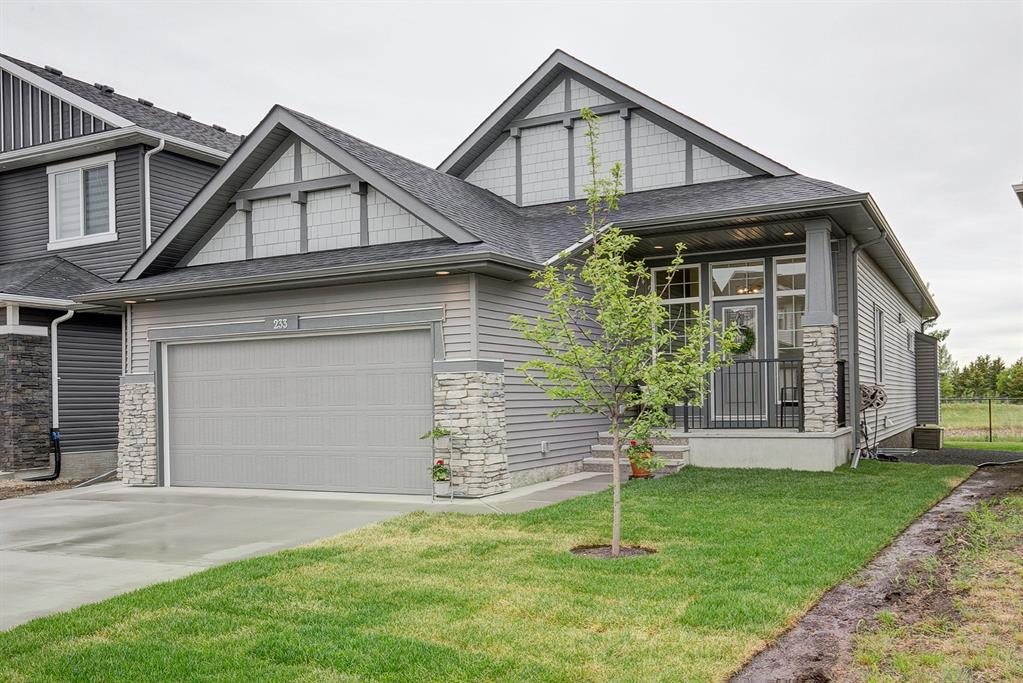 This immaculate Sterling Homes bungalow is a gem! Quiet location BACKING ONTO CANAL with a nature?s greenspace behind. Enjoy the peace & tranquility of the birds, owls and other wildlife that come for a visit. Large foyer welcomes you at the front door with tons of windows for natural light.  Bright & inviting with 10.5 foot ceilings, wonderful kitchen making cooking & entertaining a pleasure. White cabinetry, under cabinet lighting, tiled backsplash, corner pantry, quartz counters, upgraded SUBZERO & WOLF appliances including gas range, wall oven, built-in microwave + dishwasher. Functional vinyl plank flooring through the main living areas, open plan that is perfect for any furniture arrangements, gas fireplace in living room - all complimented with large windows to bring in the sunlight & enjoy the views! Perfect home office with French doors is located at the front of the house. Functional mudroom as you enter from the HEATED OVERSIZED GARAGE to accommodate workbench, extra storage + features floor drain (no muddy floors). Inviting primary suite with upgraded windows, walk-in closet with built-in shelves & drawers, 5 pc ensuite, soaker tub & separate shower. 2nd bedroom + 4 pc bathroom complete the main floor bedrooms featuring 9.5 foot ceilings. Lower level has been professionally developed by the builder with 8.5 foot ceilings, large bright family/media room, guest bedroom + 4 pc bathroom ? leaving lots of opportunity to add extra bedrooms. The yard has been landscaped & veranda built for the deck to allow you to enjoy the views, without being in the direct heat of the south exposure sun. The care & detail put into this home is evident - upgraded lighting, phantom screens, water filtration + softener, central vacuum system, window coverings ? a must see!
