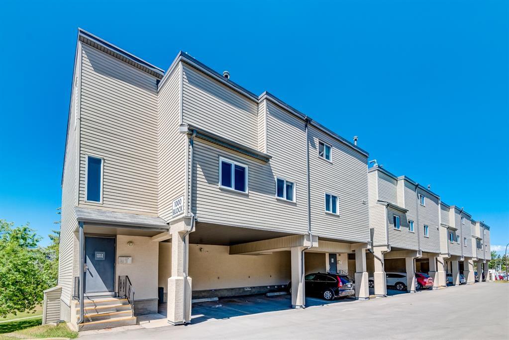 DIRECTLY ACROSS FROM FOOTHILLS HOSPITAL & NEW CALGARY CANCER CENTER!  This UPGRADED single level townhome is IDEAL FOR A FAMILY with 3 Bedrooms + Den and a large West facing deck with incredible view! Whether you work at the hospital, are a medical student, or perhaps have a family member receiving long term care, this gorgeous home is an ideal location. You will enjoy the convenience of being able to walk across the street and save hundreds per month on parking fees.   This complex is also walking distance to U of C and only a 7 minute drive to SAIT. Highly sought-after by tenants, so is also a great investment as a rental property! This spacious, well designed floor plan is one of the larger units in the complex and has plenty of room for a family. Enter into the living room which has beautiful blonde HARDWOOD FLOORS and a CORNER WOOD BURNING  FIREPLACE with white tile surround and mantle. The island kitchen features maple cabinets, GRANITE countertops, and STAINLESS STEEL APPLIANCES including a newer fridge. This is one of only a few units that recently had WINDOWS REPLACED and upgraded to casement, as well as a NEW GARDEN DOOR installed. Other improvements include a NEW HOT WATER TANK, light fixtures, and BRAND NEW CARPET which was just installed.  Ample in suite storage as well as a full-sized washer/dryer. There is an assigned covered parking stall (carport) and plenty of visitor parking. The well-managed complex has undergone recent exterior upgrades and has a healthy reserve fund. Quick possession is available!