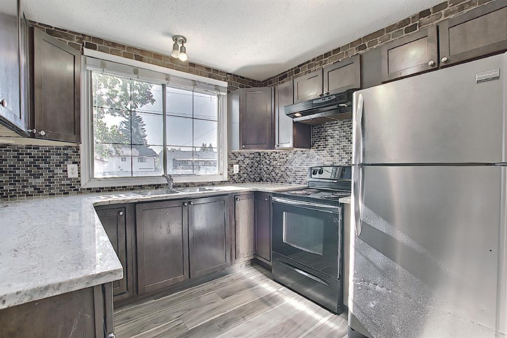 Big reduction, motivated seller, welcome to this  well maintained and renovated  Town Home in desire community of  Marlborough Park, with lowest condo fees in town. Located steps away from Amenities, Schools, shopping, assigned parking, all one need for perfect living. The main floor features great eat in kitchen, dinning area, high end vinyl throughout main floor,  over sized living room has sliding patio doors that open to a good sized fenced back yard. Upper Floor consists on 3 bedrooms, master bedroom is humongous, 4 piece washroom, flooring comes with high end carpet and full 4 pc washroom. Lower level comes with family room , bedroom and ensuite 3pc washroom,  utility room and mechanical room.  This is well maintained & Quite Complex with one of the lowest Condo Fee as mentioned earlier., call your favorite relator today.
