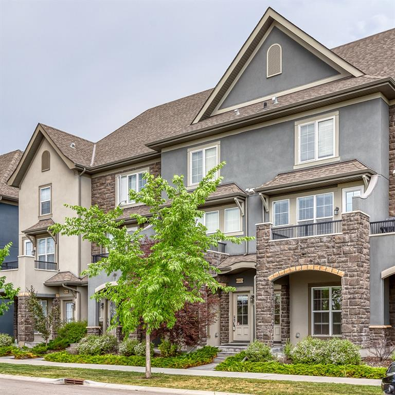 You won't want to miss this one! As new, townhome in an amazing location in the heart of Quarry Park. This unit features an oversized single attached garage, an at home office space with a sunny view, hardwood flooring throughout the main, and a stunning double-primary bedroom layout on the top floor, each with a four piece ensuite. The quiet location is stunning, with views west, which you can enjoy from your covered patio or your west facing balcony. The kitchen is a dream with stone countertops, stainless steel appliances, and a fantastic layout that also has room for an eating area. The living room is huge. This townhome is the perfect solution for the live/work lifestyle. In addition to the dedicated office/den space, you are steps from the Quarry Park business district. Walk the greenways and canals to work, transit, shopping, and all the funky pubs and eateries this award winning community has to offer! Book your private showing today!