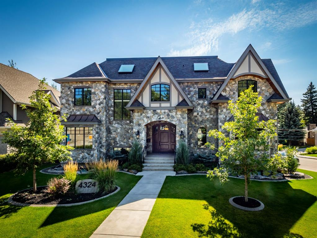 Located on regal Anne Ave in the heart of prestigious Britannia, this custom traditional home with over 6,200 square feet of living area is a must see.  Completed in early 2018, this no-costs-spared home includes walnut or mahogany built-ins in many rooms and quarter sawn white oak flooring throughout.  The house is FULLY AUTOMATED by touch pads, remote controls or your phone including lights, blinds, TVs, alarm, sprinklers, security cameras, doorbell, music, intercom and climate control.  Upstairs consists of three bedrooms, two bathrooms (ensuite has jetted tub and steam shower), a wet bar with a built-in CARBONATED WATER MACHINE and a huge laundry room with two washers, a dryer and a lot of room to hang-dry clothing.  The basement includes a bedroom with its own ensuite, a gym, a TWO LEVEL MEDIA ROOM, stairs leading down to a PLASTER WINE ROOM, a wet bar, and a games room.  It is topped off with a high-end GOLF SIMULATOR as a finishing touch for those who are golfers or who like to entertain.  Hidden off the garage, which includes an epoxy floor and custom back hanging wall, is the unique metal clad furnace room which has three boilers for the forced air system, a water softener, two air conditioners, and a water filtration system.  The house includes spray foam insulation making it economical and for dampening outside noise.  The ELEVATOR goes to all three floors to help you get around or to get the groceries to the kitchen from the underground two car garage.  You will never have to shovel your own lot as the front walkway, driveway, and both the upper and lower decks have SNOW MELT to save work on those nasty winter days.  The low-maintenance beautifully landscaped yard includes a wood burning fireplace, an outdoor sprinkler system, designer cement curbs and a stucco privacy fence to make the back yard your own are just some of the outdoor features.  What outside is complete without gorgeous cedar soffits, lighting and a stunning custom 9-foot front door.  The