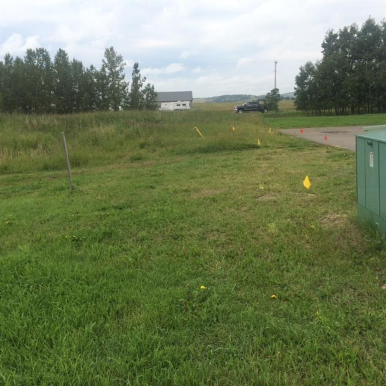 This vacant lot is approved for an attached villa condo  with a DOUBLE garage and rear balcony.  The adjoining lot is approved for a SINGLE garage villa. Plans must be submitted to the condo board for approval.Bring your own builder (plans must be submitted to the condo board for approval first). The Ridgestone is an adult community just south of the Oilfields Hospital.  Shopping, restaurants and recreational facilities are within walking distance. Big box stores are a 15 minute drive in Okotoks and and the Kananaskis is a short drive west of town.