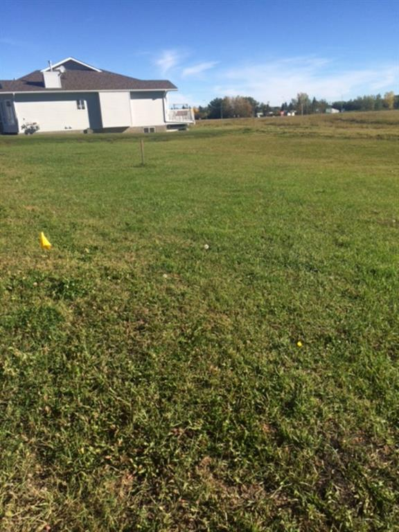 This vacant lot is approved for an attached villa condo with a SINGLE garage and rear deck. The adjoining lot is approved for a SINGLE garage condo villa. Bring your own builder (plans must be submitted to the condo board for approval first). The Ridgestone is an adult community just south of the Oilfields Hospital.  Shopping, restaurants and recreational facilities are within walking distance. Big box stores are a 15 minute drive in Okotoks and and the Kananaskis is a short drive west of town.