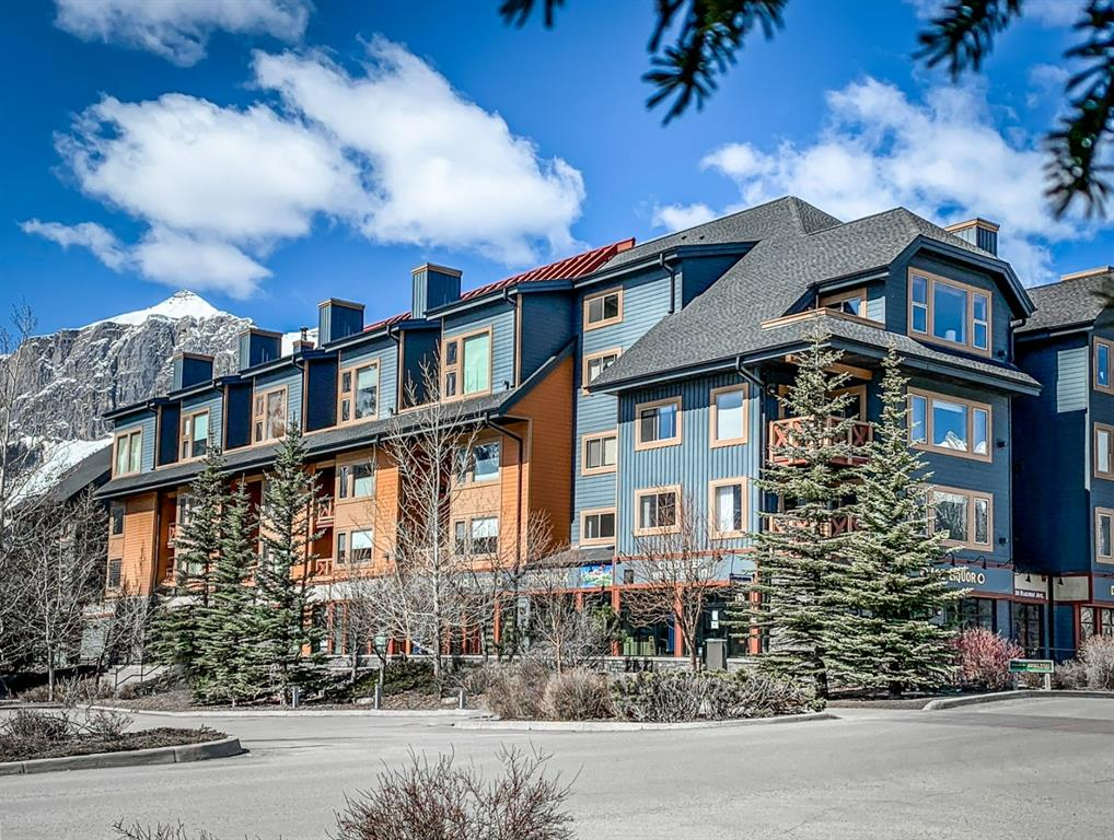 Top floor 2 bedroom 'Tourist Home' condo in downtown Canmore! This fully furnished, top-floor corner unit with vaulted ceilings provides you with Canmore's most flexibility zoning for full-time living or short-term guest rentals for revenue income! Located in downtown Canmore just a short walk from all amenities, Bow River trails, Main Street shops and restaurants - this home will appeal to investors and full-time home owners alike. The unit benefits from mountain views, a huge kitchen for entertaining, toe-warming in-floor radiant heat in the kitchen and bathrooms, and substantial additional in-suite storage. The huge master suite is a delightful space to relax, with 2nd bedroom and additional pull-out sofa beds in the living area for additional guests. Fully furnished and ready for your guest rentals through platforms like AirBnB, or through your preferred rental management company. Fabulous roof-top hot tub with stellar mountain views, and exercise room on site. Secure underground parking with storage.
