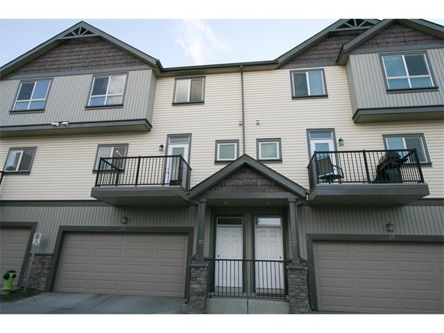 Immaculate 3 storey townhome with a great location surrounded by serene, open spaces and backing West on to a ravine. This gem gets plenty of sun has a deck in the front and 2 patios in the back.  You will love the contemporary kitchen complete with granite countertops, tile backsplash & island. The kitchen allows the chef to interact with guests via the very open & spacious floor plan -- overlooking the large dining area  & the great room with a cozy fireplace. Entire main floor boasts beautiful hardwood floors & large windows to let in tonnes of natural light. The upper level has three bedrooms with a large Master suite complete with a spacious walk-in closet & a convenient 4-pce en suite. Two additional bedrooms share the main bath & super convenient upper level laundry closet complete the upstairs. Don't forget the double garage to keep you & your vehicle cozy all winter along with an enormous storage room! Close to shopping & restaurants. This home is a must see!