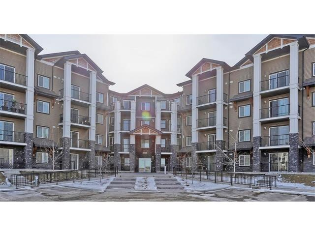 This fantastic, open concept, 1 bedroom condo in Panorama Hills is a must see. A Cardel Lifestyles Development property; this is a good builder with a good reputation. This condo is a great property for a first time buyer or savvy investor. This building is just a couple years old, and the unit features include in suite laundry, underground secured and heated parking, gas bbq hook up, condo fees of 275 dollars per month that include everything except electricity. This main floor unit is move in ready with neutral paint colours, medium brown cupboards throughout, and has been very well cared for. Walking distance to groceries, coffee shop, restaurants and just a short 5 minute drive to the shopping centre on Country Hills with everything you could need from the movie theatre, to banking and restaurants. Call your favourite Realtor to view this condo today!