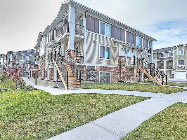 Come out and have a look at this fantastic 2 bedroom condo located in desirable Chestermere Station. This condo is just steps away from all of the Shopping and Amenities you could want, including the Lake. This 2nd floor, open concept, corner unit is ready to move in or alternatively to keep as a fully managed investment property with tenant in place. With neutral paint colours, a trendy kitchen with large island space, in suite laundry with extra room for storage, an assigned parking spot with plug, and low condo fees of under 135 dollars a month (each unit has their own furnace and hot water tank), this is amazing value in the town of Chestermere.  This complex does allow pets and you may have up to 2 cats or 2 dogs or 1 of each, birds in a cage and fish in a tank are just fine too. Call your favourite Realtor to book your showing today!