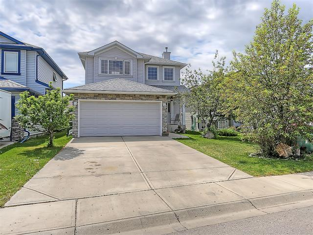 *Open House - Saturday June 13th from 2-4:00* Welcome to this fantastic family home in the North Airdrie community of Stonegate. Close to all area amenities, you'll love the quiet neighbourhood streets and value the short walk or drive to grab groceries for dinner. Bright and inviting with its vaulted front entrance ceilings, this house is ready for your personal touch. The main level is open concept and features a good sized living room with fireplace, large kitchen with eat in dining area that accommodates a full sized table, a convenient half bath and laundry facilities. Upstairs you will find the Master bedroom with large ensuite washroom with walk in closet, and 2 additional bedrooms. The fully finished lower level contains a large rec room, wet bar, and another bedroom.  The back yard is fully fenced, includes 2 small storage sheds, a great kids play set, a deck and patio area. Call your favourite Realtor to view today!