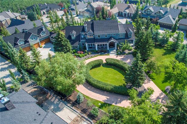 A rare gem in the heart of prestigious Aspen Estates, this extensively landscaped one acre property is comprised of two separate titled lots in a private cul-de-sac.  The Manor House combines old-world charm and modern convenience in a warm family home.  Wrapped entirely in stone, with nearly 10,000 sq. ft. of luxurious living quarters across 3 levels, the estate is constructed to the highest standards with 5 bedrooms, 7 bathrooms, 2 powder rooms and 1,200 sq. ft. patio.  A carriage house (+1,000 sq. ft.) tops a 2-level, 7-car garage connected to the main house by enclosed galleria.  Highlights include a gourmet kitchen, great room with grand fireplace and coffered ceiling, charming drawing room with vaulted ceiling, gracious dining room, Irish pub-style bar, media room, hot tub sunroom, and elevator. Opportunity to build additional estate home on the second lot at 10 Aspen Ridge Lane.  Offering exquisite interior and exterior spaces, the Manor House is truly an extraordinary landmark legacy estate.