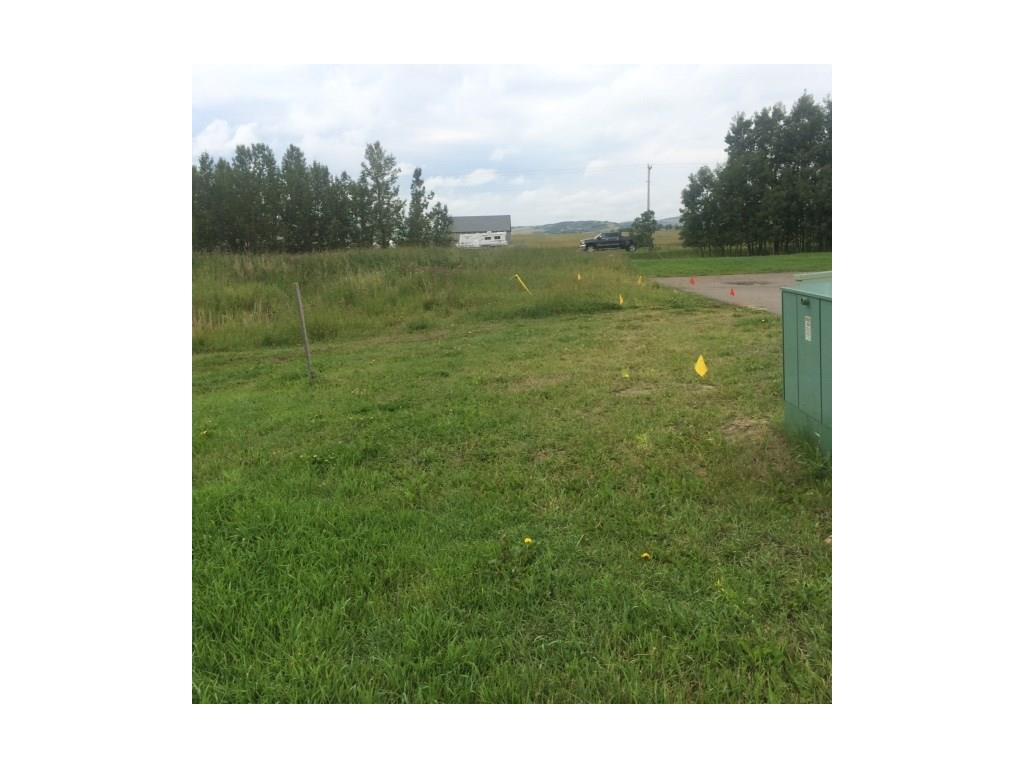 This vacant lot is approved for an attached villa condo with a SINGLE garage and balcony.  The adjoining lot is approved for a SINGLE garage villa.  Plans must be submitted to the condo board for approval before building.  BRING YOUR OWN BUILDER!  The Ridgestone is a wonderful 45+ Adult community composed of 48 Villa units, 20 Garden Suites, and 17 independent living apartments at the Lodge - A Living In Place concept.  Shopping and restaurants are within walking distance and the Hospital and Long Term Care are across the street from the community.  Curling, skating, fishing and community clubs are also in the neighbourhood.  Big box stores are 15 minutes away and Kananaskis recreation is just a short drive west.