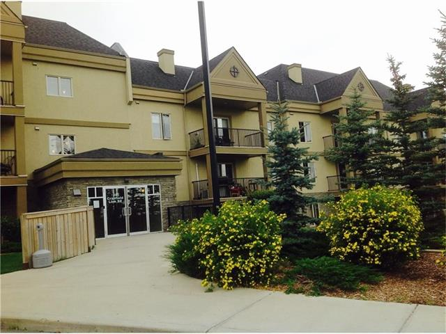 ( Open House Sunday Oct 23  1pm-5pm ) STUNNING! LOCATION !   2nd floor suite, quite 18+ adult living Complex is very well maintained with GRANITE counter tops in the kitchen and bathroom , maple stained cabinetry with a very warming natural painted wall colors throughout. The open living room has a beautiful corner GAS FIREPLACE. Plus Patio doors opening out for BBQ surround by beautiful landscaping. The MASTER SUITE includes a large WALK THRU closet leading to the four piece EN SUITE BATHROOM. An Open den provides a great additional living. This condo also includes a well equipped Gym, Movie theater, Jacuzzi tub, Games room with a Pool table and a Car wash bay in parking level. Easy access to Shopping, Public Transportation, Pubs and a NEW S.E Health Campus Hospital .This condo is a MUST SEE!