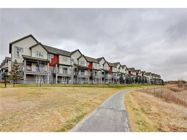 Location, location, location. This 3-bedroom, 2.5 bath walkout townhouse has over 1700 sq. ft. of bright & open living space, and overlooks Copperfield's wildflower pond & pathway system. The concept main floor features a stunning oversized kitchen with granite countertops, glass tile backsplash, gas Jenn-Air stove, Samsung stainless steel fridge, Kenmore Elite dishwasher, built-in pantry, large island with breakfast bar & new flooring. The main level also features walnut hardwood flooring, a Napolean gas fireplace with marble surround and spacious dining area. The upper level includes a fabulous master bedroom with walk through closet & 4 piece ensuite, plus two additional bedrooms, the 4 piece main bath & laundry area. The walkout has been developed to include a large home office, den or play area for the kids.  Recent renovations include new carpets, paint & updated plumbing. Low condo fees, minutes to shopping, amenities & easy access to Deerfoot Trail & Stoney Trail. Exceptional value under 370k!