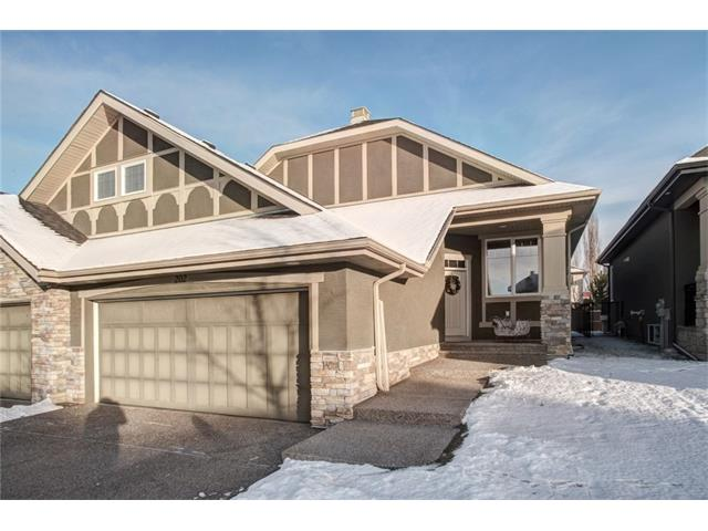 Beautiful Villa Style Bungalow with NO FEE'S! This lovely home boasts close to 2,100 sq/ft of functional and oppulant living. It's situated 1 block from the beautiful pathways of Fish Creek Park overlooking the Bow River Valley. The main floor features an elegant living room with cathedral ceiling, a dining room with double glass doors, a large open concept kitchen, den, half bath, laundry and a master bedroom with luxurious 5pc ensuite. Gourmet kitchen features maple cabinetry, high-end stainless steel appliances, and island with granite counter top. Lower level is fully developed and features a 9 ft ceilings, family room, large bedroom and 3 pc bath. A very well cared for home with amazing nature and pathways just steps away!